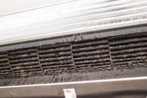 Air conditioner prier to cleaning. The build-up of dust is quite evident.​